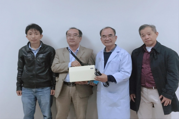 PHAN CHAU TRINH UNIVERSITY SUPPORTING MOUNTING MACHINE TO HIEP DUC DISTRICT MEDICAL CENTER